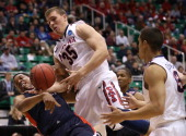Kaleb Tarczewski of the Arizona Wildcats grabs the ball against Blake Jenkins of the Belmont Bruins in the first half during the second round of the...