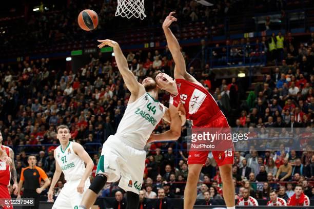 Kaleb Tarczewskiat dx and Antanas Kavaliauskas fight for a rebound during a game of Turkish Airlines EuroLeague basketball between AX Armani Exchange...
