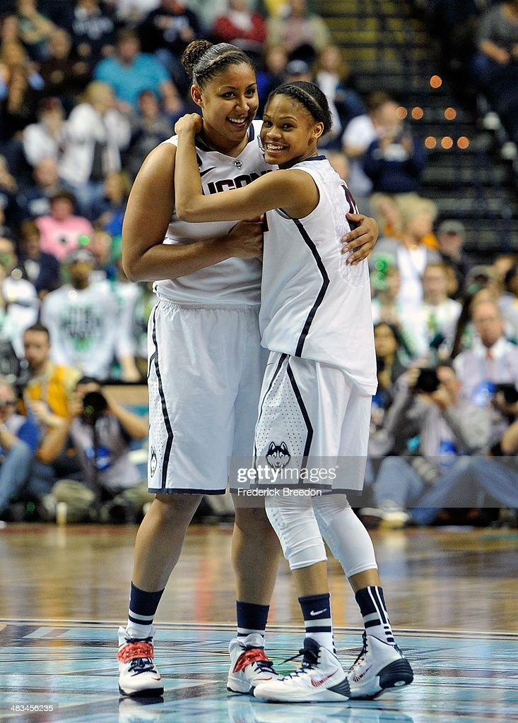 Kaleena Mosqueda #23 of the Connecticut Huskies embraces teammate Moriah Jefferson #4 during the final moments of a 79-58 victory over the Notre Dame Fighting Irish in the NCAA Women's Basketball Tournament Championship game at Bridgestone Arena on April 8, 2014 in Nashville, Tennessee.