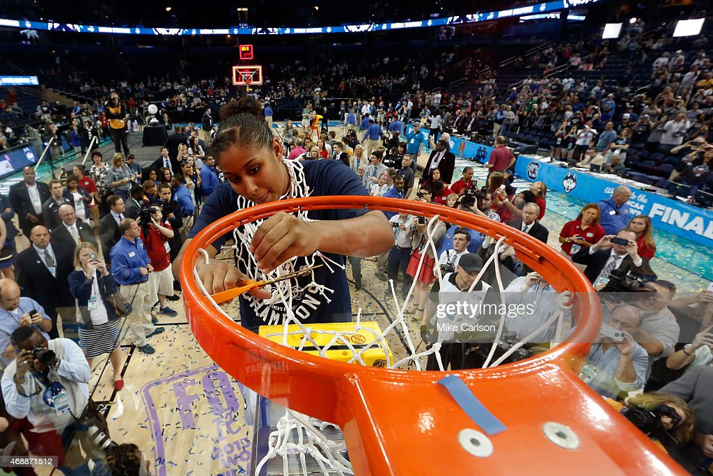 Kaleena Mosqueda-Lewis #23 of the Connecticut Huskies cuts the net after defeating the Notre Dame Fighting Irish 63-53 during the NCAA Women's Final Four National Championship at Amalie Arena on April 7, 2015 in Tampa, Florida.