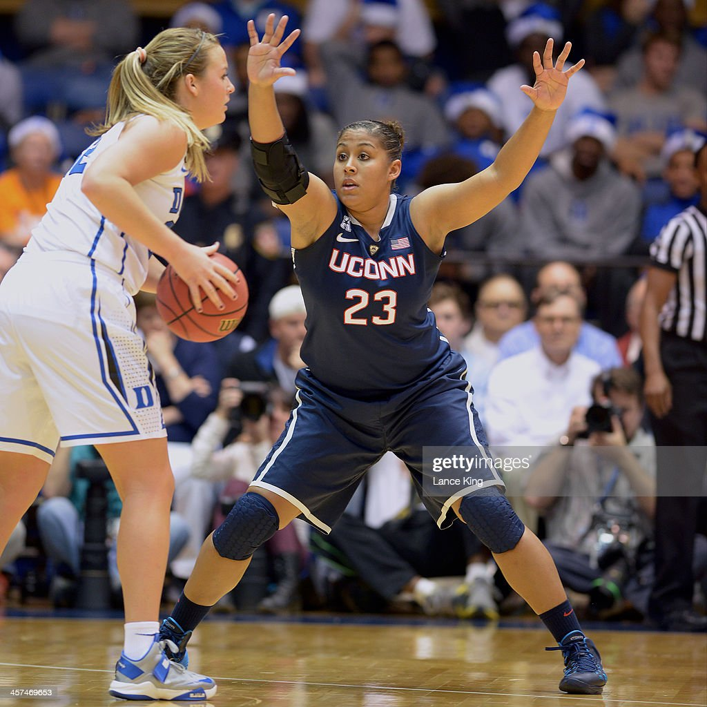 Kaleena Mosqueda-Lewis #23 of the Connecticut Huskies defends Tricia Liston #32 of the Duke Blue Devils at Cameron Indoor Stadium on December 17, 2013 in Durham, North Carolina. Connecticut defeated Duke 83-61.
