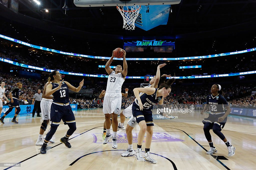 Kaleena MosquedaLewis of the Connecticut Huskies goes to the basket against the Notre Dame Fighting Irish during the NCAA Women's Final Four National...