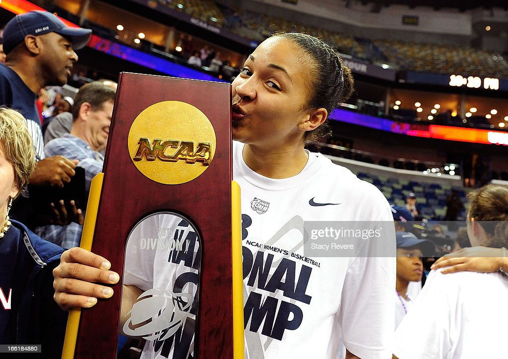 Kaleena Mosqueda-Lewis #23 of the Connecticut Huskies kisses the National Championship Trophy after defeating the Louisville Cardinals during the 2013 NCAA Women's Final Four Championship at New Orleans Arena on April 9, 2013 in New Orleans, Louisiana.
