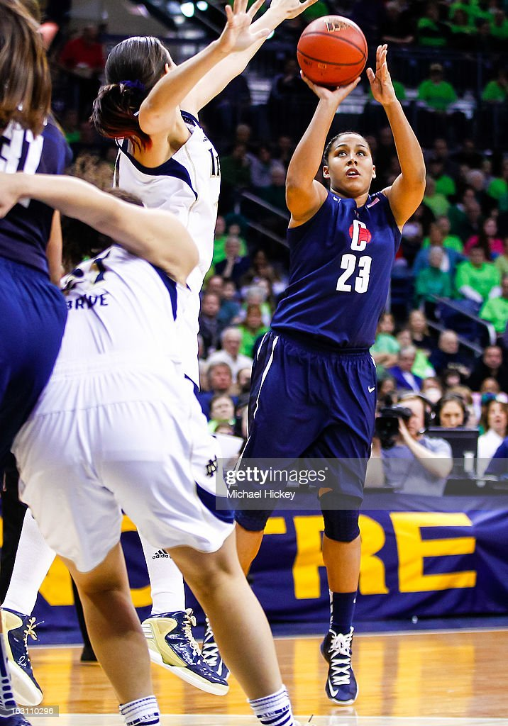 Kaleena Mosqueda-Lewis #23 of the Connecticut Huskies shoots the ball against Natalie Achonwa #11 of the Notre Dame Fighting Irish at Purcel Pavilion on March 4, 2013 in South Bend, Indiana. Notre Dame defeated Connecticut 96-87 in triple overtime to win the Big East regular season title.