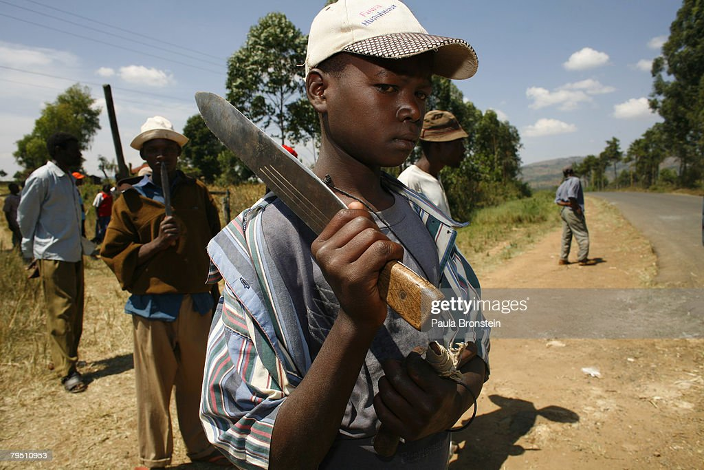 Kalegins tribe member watches for the rival tribes armed with a machete February 4 2008 in Sotik Kenya Sparked by December's disputed elections...