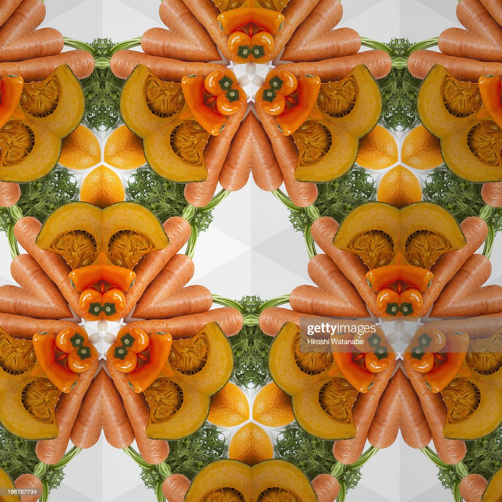 kaleidoscope of orange vegetables and fruits stock photo getty