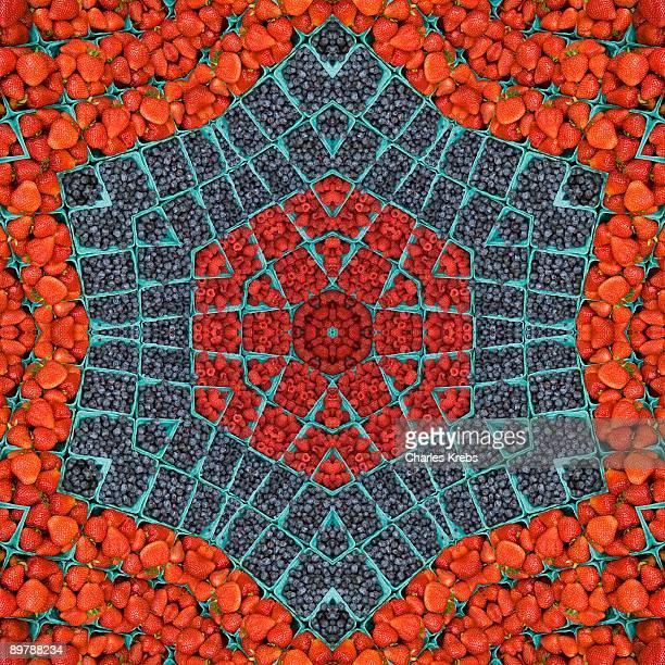 Kaleidoscope of strawberries and blueberries