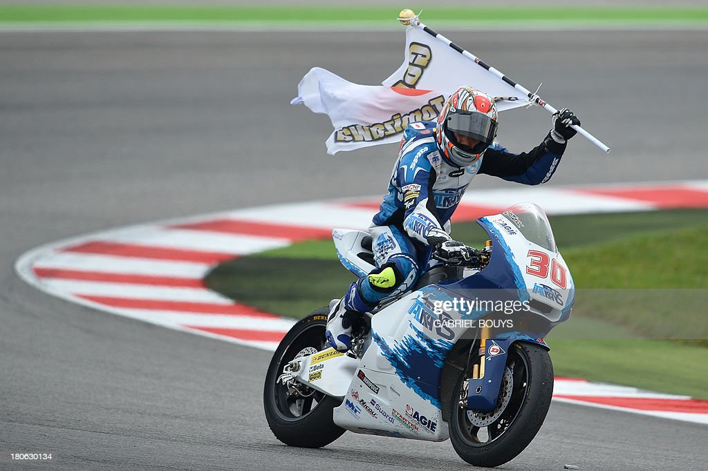 Kalex rider Takaaki Nakagami of Japan celebrates after taking the second place of the Moto 2 race, part of the San Marino MotoGP Grand Prix on September 15, 2013 at the Misano world circuit in Misano Adriatico. Pol Espargaro of Spain won the race ahead of Japanese Takaaki Nakagami and Esteve Rabat of Spain.
