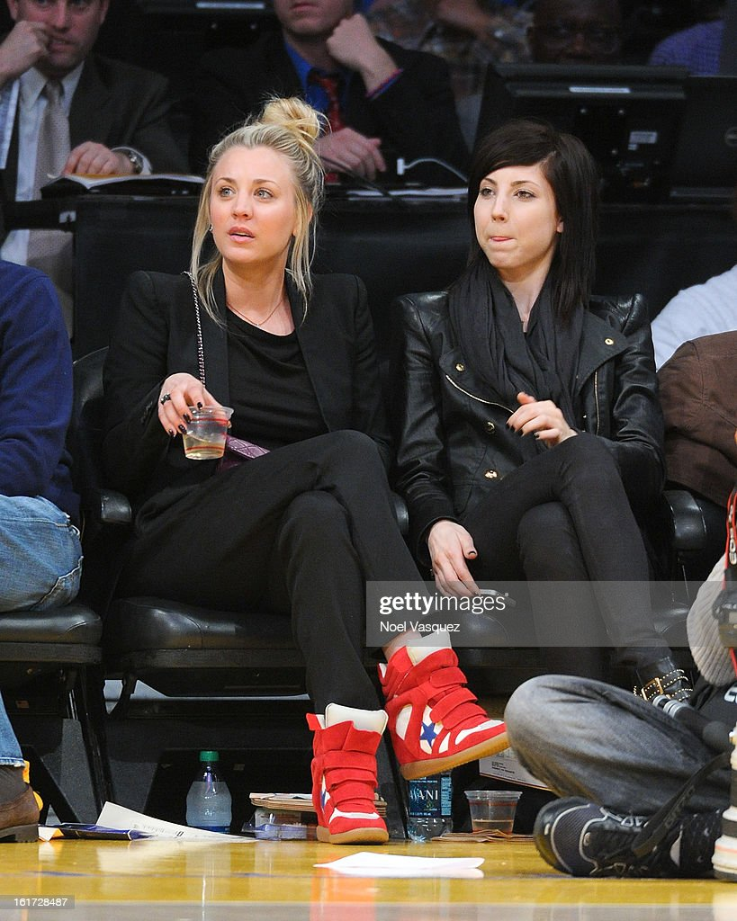 <a gi-track='captionPersonalityLinkClicked' href=/galleries/search?phrase=Kaley+Cuoco&family=editorial&specificpeople=208988 ng-click='$event.stopPropagation()'>Kaley Cuoco</a> (L) and her sister Briana Cuoco attends a basketball game between the Los Angeles Clippers and the Los Angeles Lakers at Staples Center on February 14, 2013 in Los Angeles, California.