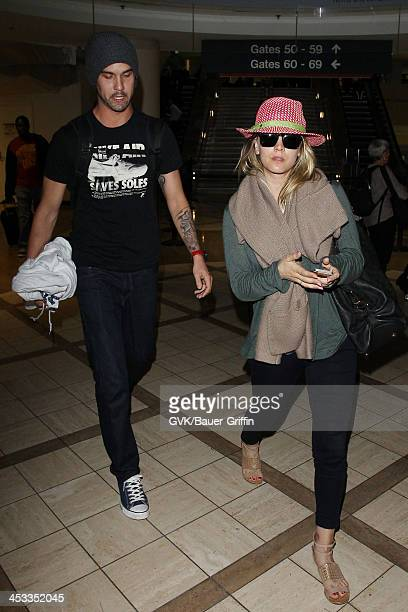 Kaley Cuoco and Ryan Sweeting are seen arriving at LAX airport on December 03 2013 in Los Angeles California