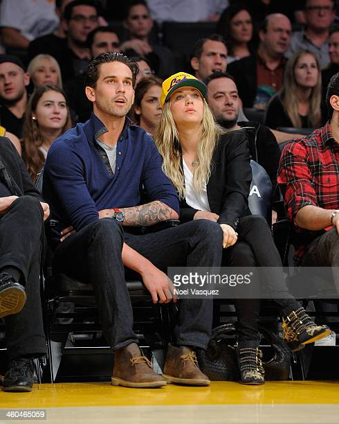Kaley Cuoco and Ryan Sweeting attend a basketball game between the Utah Jazz and the Los Angeles Lakers at Staples Center on January 3 2014 in Los...