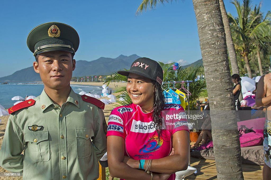 Kalia Moniz of Hawaii poses with a Chinese official after winning her round one heat at the SWATCH Girls Pro China on November 21, 2012 in Hainan Island, China. Kalia placed second in this event last year. By winning round one, Kalia advanced to round three.