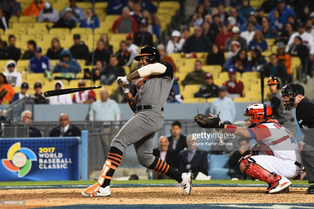 Kalian Sams #35 of the Netherlands shatters his bat at the plate in the ninth inning against team Puerto Rico during Game 1 of the Championship Round of the 2017 World Baseball Classic at Dodger Stadium on March 20, 2017 in Los Angeles, California.
