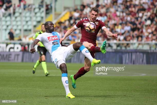 Kalidou Koulibaly and Andrea Belotti compete for the ball during the Serie A football match between Torino FC and SSC Napoli at Olympic stadium...