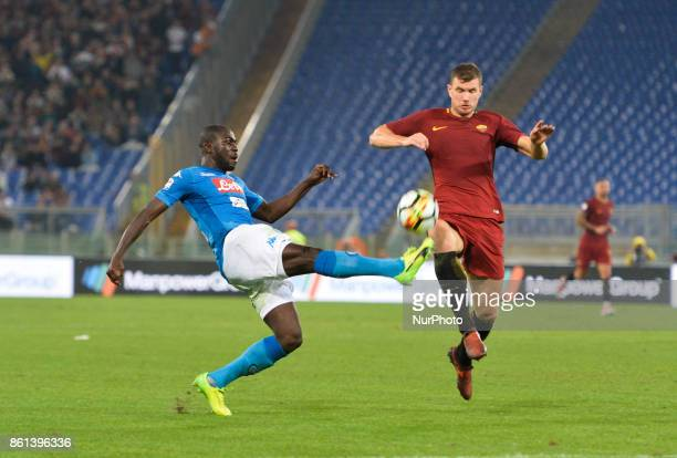 Kalidou Koulibaly and Edin Dzeko during the Italian Serie A football match between AS Roma and SSC Napoli at the Olympic Stadium in Rome on october...