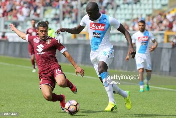 Kalidou Koulibaly and Iago Falque compete for the ball during the Serie A football match between Torino FC and SSC Napoli at Olympic stadium Grande...