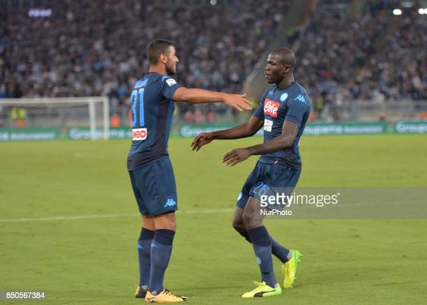Kalidou Koulibaly celebrates with Faouzi Ghoulam after scoring a goal during the Italian Serie A football match SS Lazio vs SSC Napoli at the Olympic...