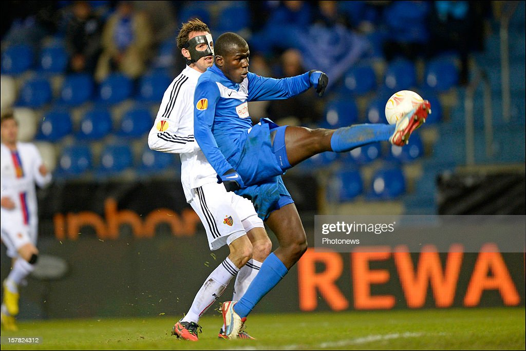 Kalidou Koulibaly (R) of KRC Genk in front of <a gi-track='captionPersonalityLinkClicked' href=/galleries/search?phrase=Marco+Streller&family=editorial&specificpeople=534494 ng-click='$event.stopPropagation()'>Marco Streller</a> of FC Basel 1893 during the UEFA Europa League group G match between KRC Genk and FC Basel 1893 at the Cristal Arena stadium on December 06, 2012 in Genk, Belgium.