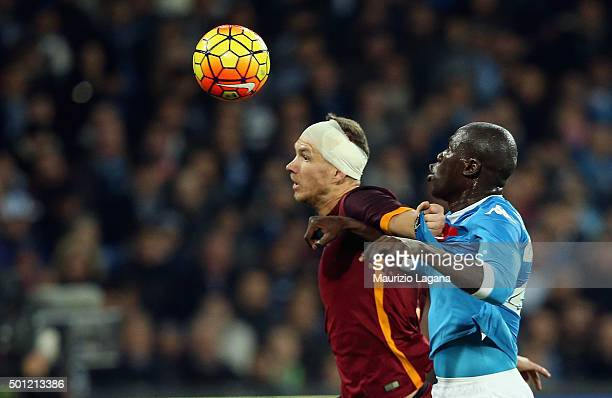 Kalidou Koulibaly of Napoli competes for the ball with Edin Dzeko of Roma during the Serie A match betweeen SSC Napoli and AS Roma at Stadio San...