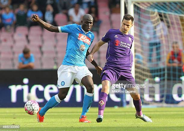 Kalidou Koulibaly of Napoli competes for the ball with Nikola Kalicic of Fiorentina during the Serie A match between SSC Napoli and ACF Fiorentina at...