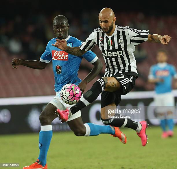 Kalidou Koulibaly of Napoli competes for the ball with Simone Zaza of Juventus during the Serie A match between SSC Napoli and Juventus FC at Stadio...