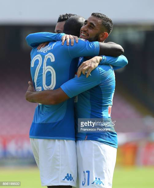 Kalidou Koulibaly of SSC Napoli celebrates with teammate Faouzi Ghoulam after scoring his team's third goal during the Serie A match between SSC...