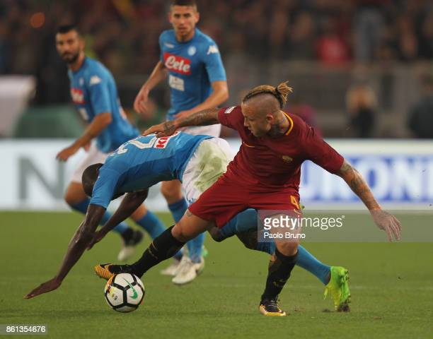 Kalidou koulibaly of SSC Napoli competes for the ball with Radja Nainggolan of AS Roma during the Serie A match between AS Roma and SSC Napoli at...