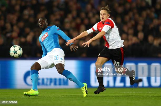 Kalidou Koulibaly of SSC Napoli is challenged by Jens Toornstra of Feyenoord during the UEFA Champions League group F match between Feyenoord and SSC...