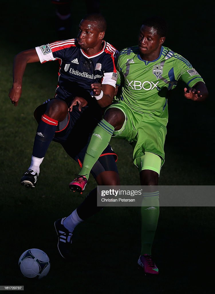 Kalifa Cisse #4 of the New England Revolution and Eddie Johnson #7 of the Seattle Sounders attempt to control the ball during FC Tucson Desert Diamond Cup at Kino Sports Complex on February 13, 2013 in Tucson, Arizona. The Sounders defeated the Revolution 2-0.