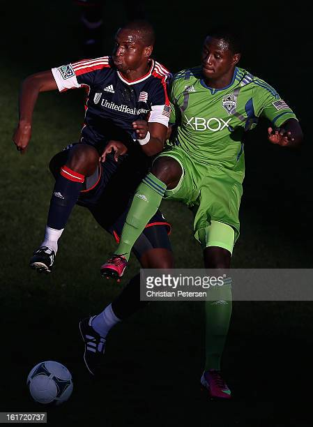 Kalifa Cisse of the New England Revolution and Eddie Johnson of the Seattle Sounders attempt to control the ball during FC Tucson Desert Diamond Cup...