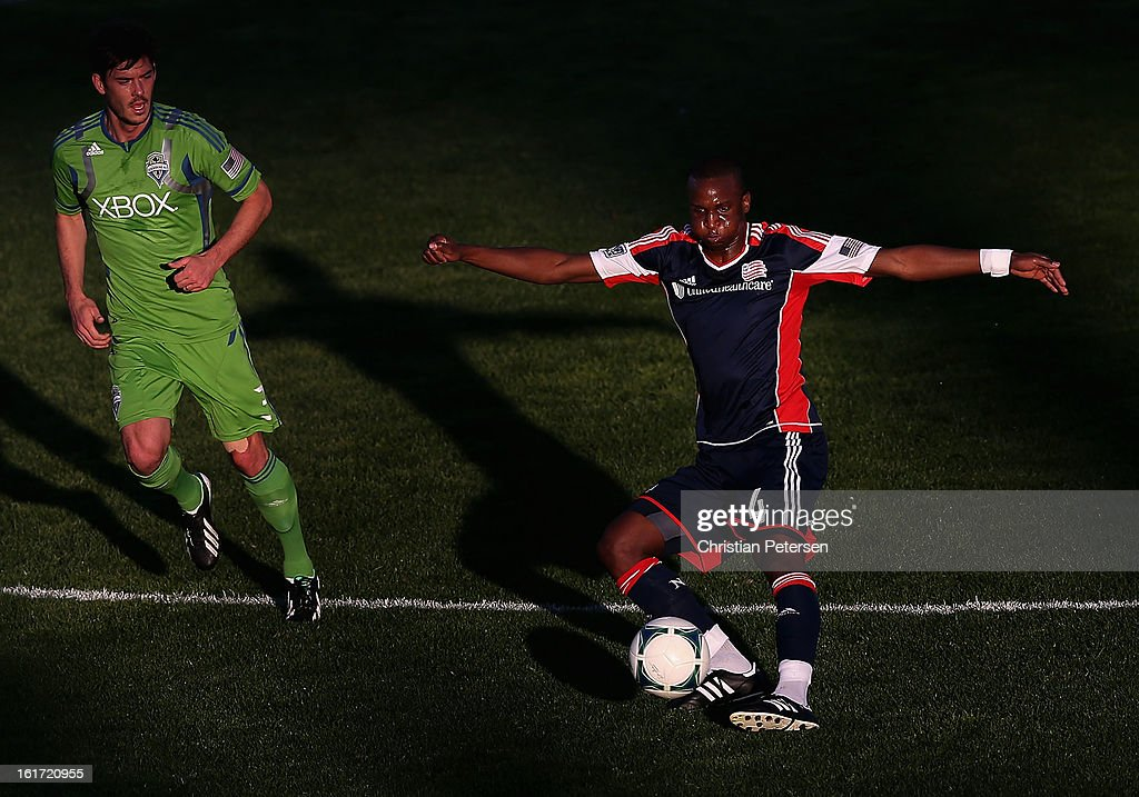 Kalifa Cisse #4 of the New England Revolution passes the ball during FC Tucson Desert Diamond Cup against the Seattle Sounders at Kino Sports Complex on February 13, 2013 in Tucson, Arizona. The Sounders defeated the Revolution 2-0.