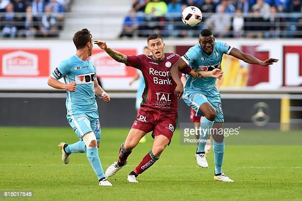 Kalifa Coulibaly forward of KAA Gent Brecht Dejaegere midfielder of KAA Gent and Luca Marrone midfielder of SV Zulte Waregem pictured during the...