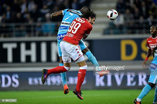 Kalifa Coulibaly forward of KAA Gent scoring the opening goal from a corner in front of Ishak Belfodil forward of Standard Liege during the Jupiler...