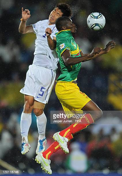 Kalifa Coulibaly of Mali duels for a high ball with Hwang Do Yeon of Korea Rupublic during the FIFA U20 World Cup Colombia 2011 group A match between...