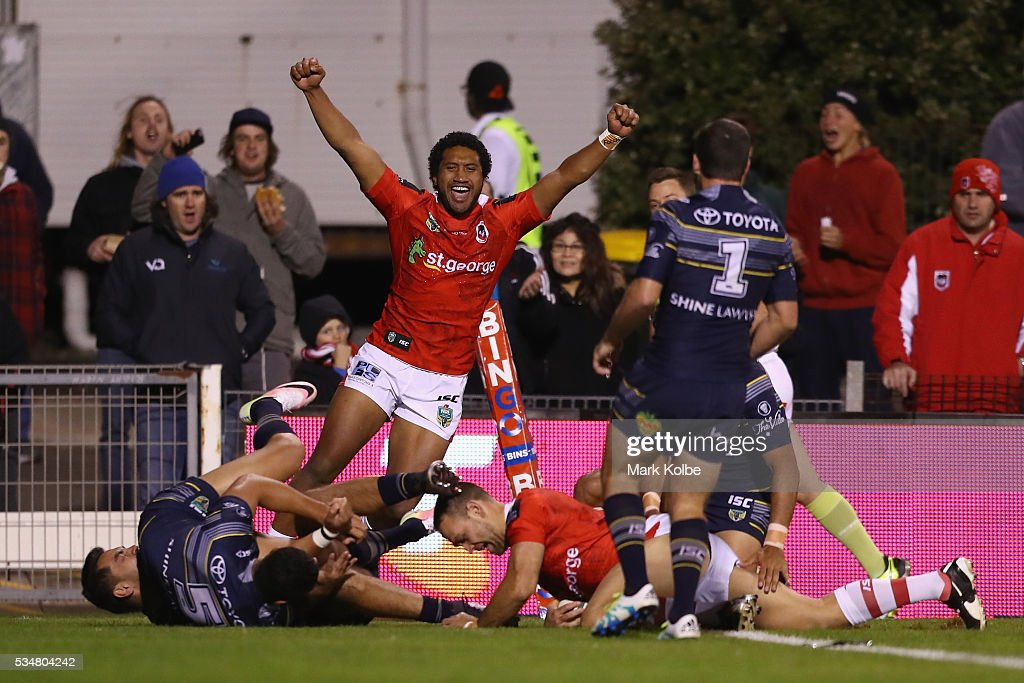 Kalifa Faifai Loa of the Dragons celebrates Jason Nightingale of the Dragons scoring a try during the round 12 NRL match between the St George Illawarra Dragons and the North Queensland Cowboys at WIN Jubilee Stadium on May 28, 2016 in Wollongong, Australia.