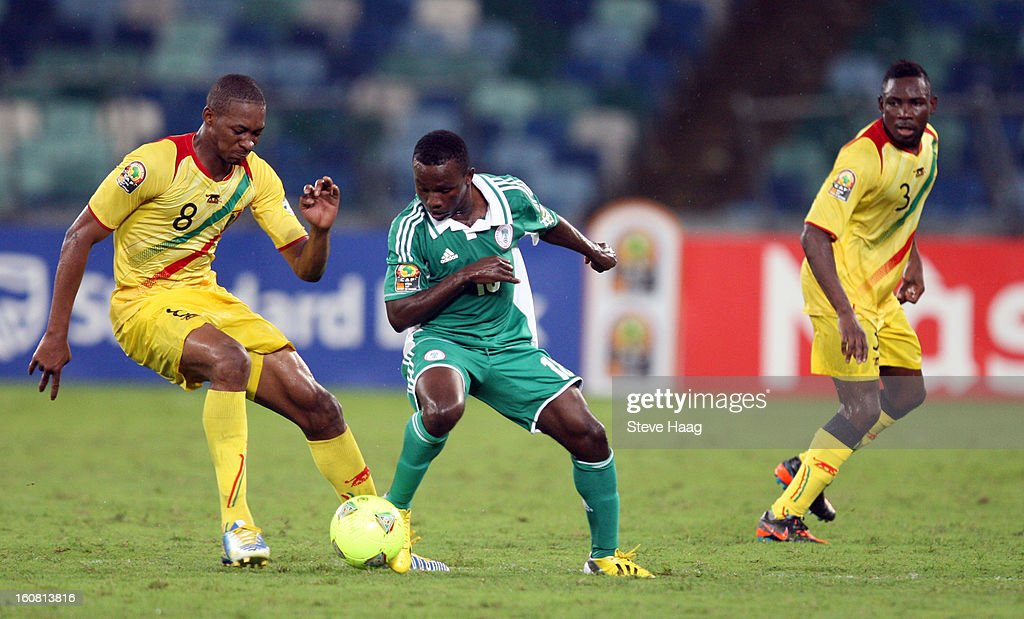 Kalilou Traore of Mali competes for the ball with Ejike Uzoenyi of Nigeria during the 2013 African Cup of Nations Semi-Final match between Mali and Nigeria at Moses Mahbida Stadium on February 06, 2013 in Durban, South Africa.