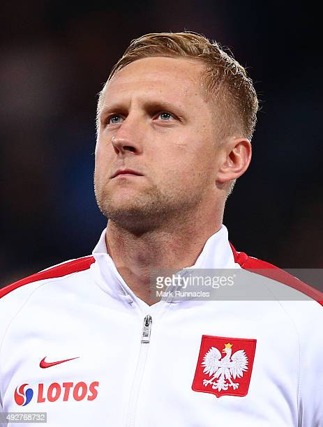 Kalim Glik of Poland line up for the national anthem during the EURO 2016 Qualifier between Scotland and Poland at Hamden Park on October 8 2015 in...