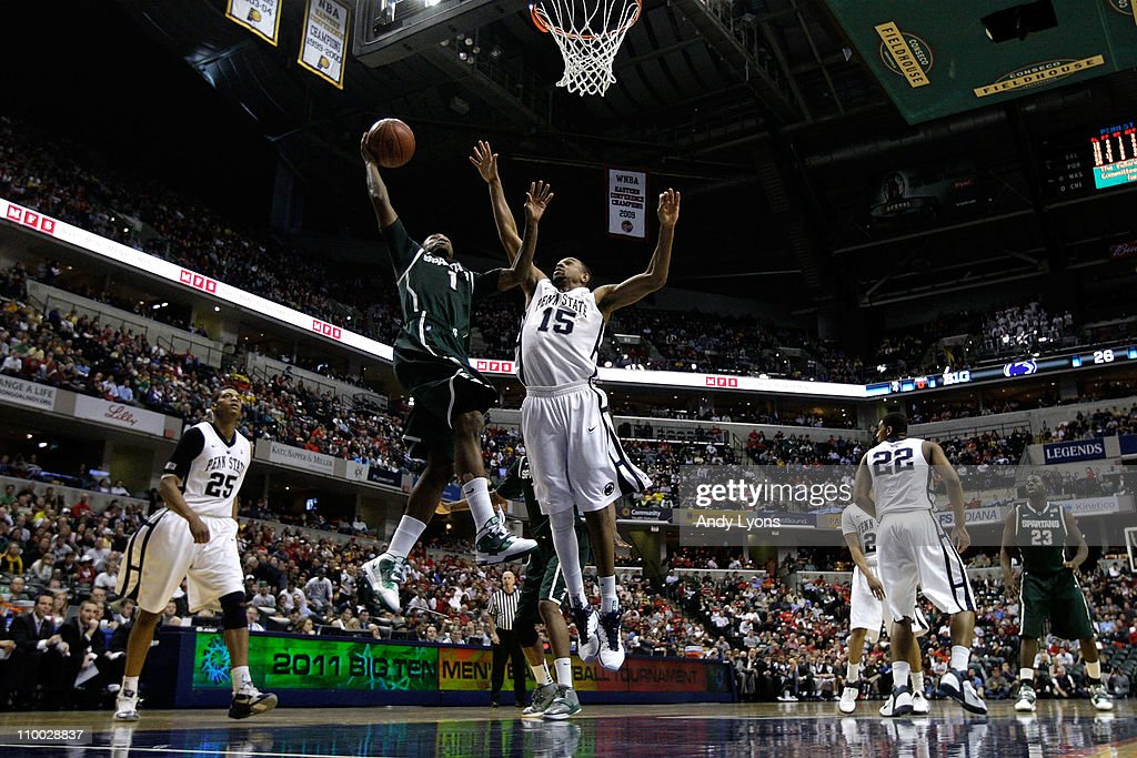 Kalin Lucas of the Michigan State Spartans drives for a shot attempt David Jackson of the Penn State Nittany Lions during the semifinals of the 2011...