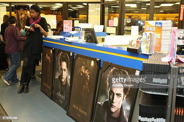 Kalin Wilson reads a book while waiting for the New Moon cast members to arive the 'The Twilight Saga New Moon' DVD release at Blockbuster Brookhaven...