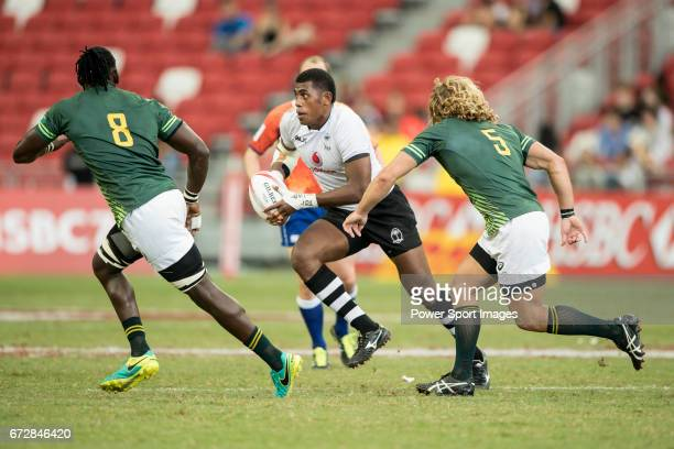 Kalione Nasoko of Fiji runs with the ball during the match Fiji vs South Africa Day 2 of the HSBC Singapore Rugby Sevens as part of the World Rugby...