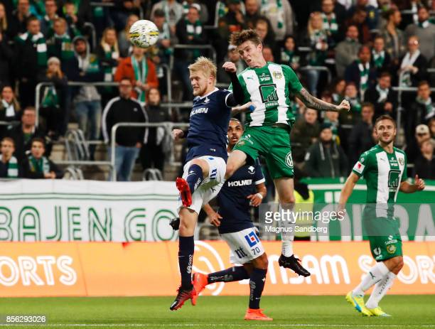 Kalle Holmberg of IFK Norrkoping and Birkir Már Sævarsson of Hammarby IF during the Allsvenskan match between Hammarby IF and IFK Norrkoping at Tele2...