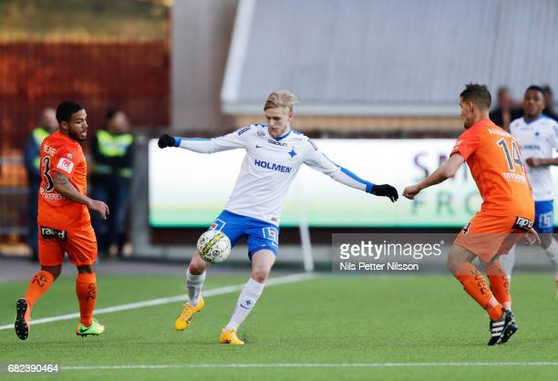 Kalle Holmberg of IFK Norrkoping and Jernade Mead and Mauricio Albornoz of Athletic FC Eskilstuna competes for the ball during the Allsvenskan match...
