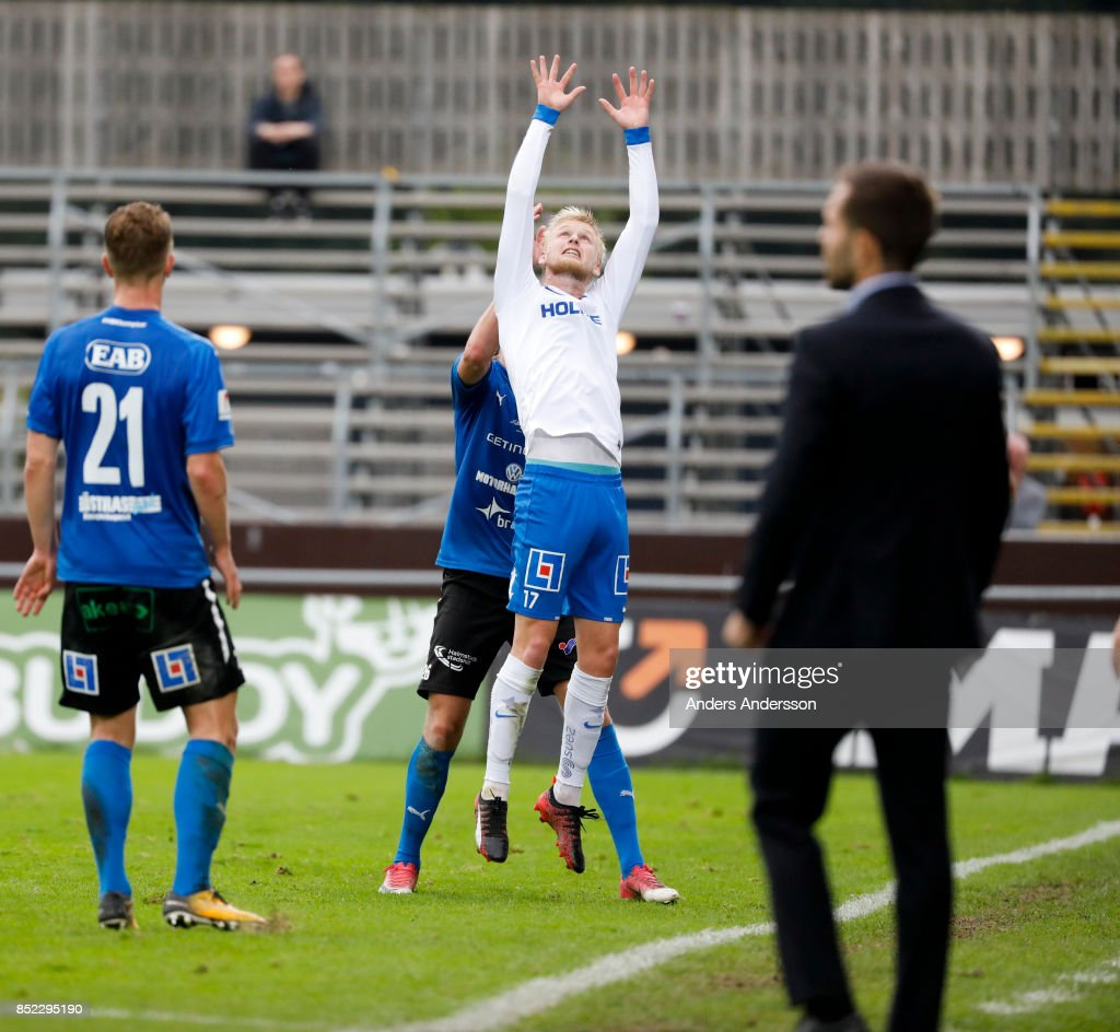 Kalle Holmberg of IFK Norrkoping jumps for a ball in competition with Alexander Berntsson of Halmstad BK at Orjans Vall on September 23, 2017 in Halmstad, Sweden.