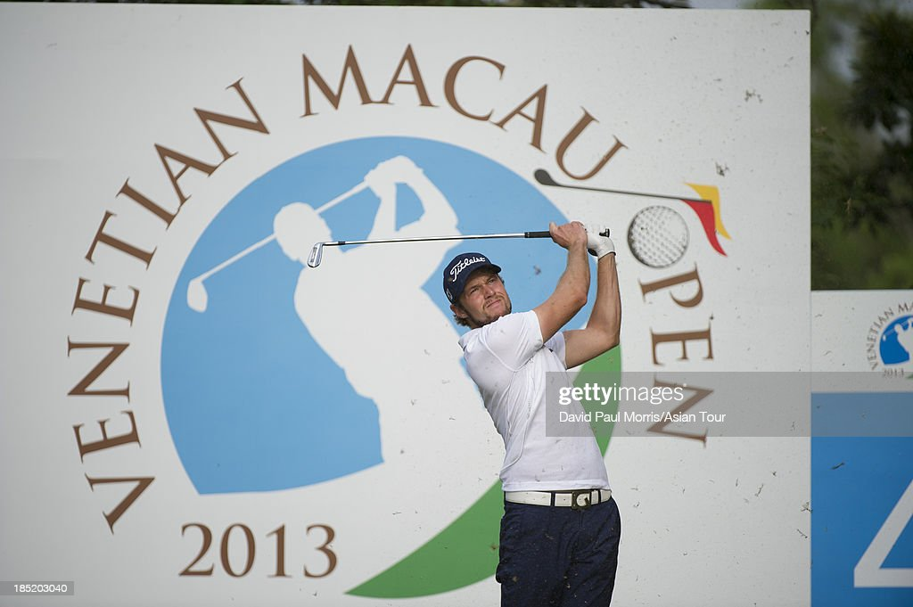 Kalle Samooja of Finland hits his tee shot on the 4th hole during round two of the Venetian Macau Open on October 18, 2013 at the Macau Golf & Country Club in Macau. The Asian Tour tournament offers a record US$ 800,000 prize money which goes through October 20.