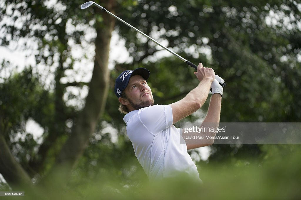 Kalle Samooja of Finland hits his tee shot on the 5th hole during round two of the Venetian Macau Open on October 18, 2013 at the Macau Golf & Country Club in Macau. The Asian Tour tournament offers a record US$ 800,000 prize money which goes through October 20.