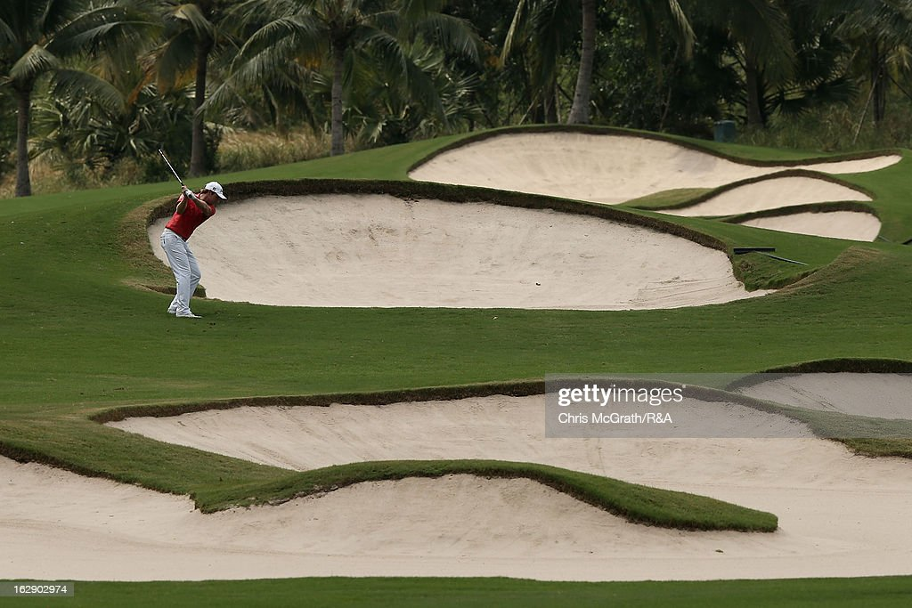 Kalle Samooja of Finland plays his second shot on the 11th hole during round two of The Open Championship International Final Qualifying Asia at Amata Springs Country Club on March 01, 2013 in Bangkok, Thailand.