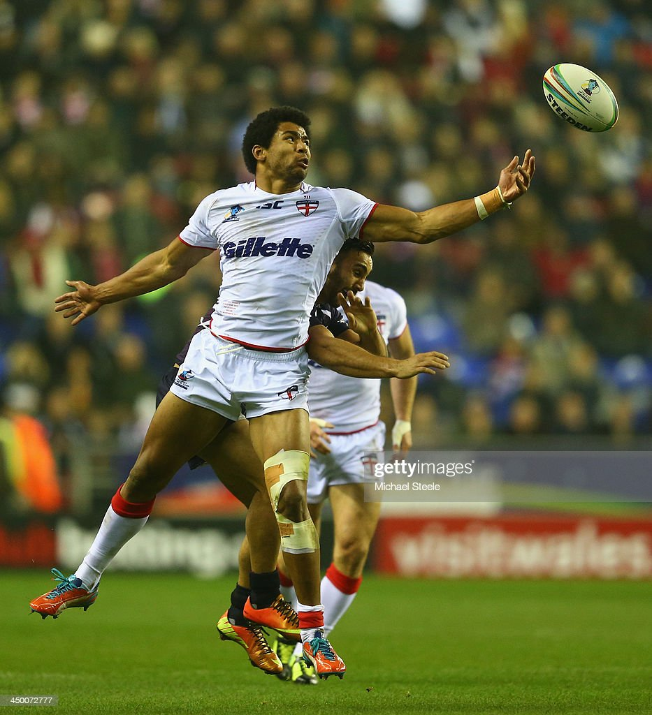 Kallum Watkins of England challenges for the ball alongside Eloi Pelissier of France during the Rugby League World Cup Quarter Final match between...