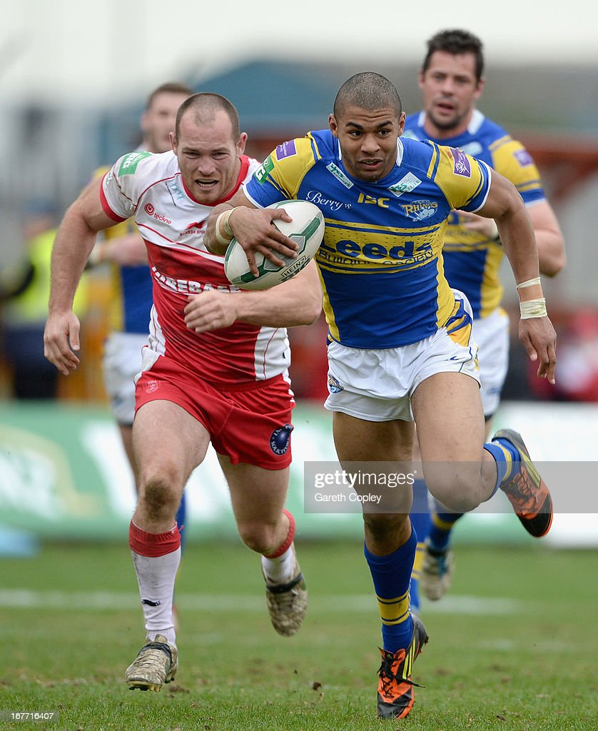 Kallum Watkins of Leeds gets past Rhys Lovegrove of Hull KR during the Super League match between Hull Kingston Rovers and Leeds Rhinos at Craven Park Stadium on April 28, 2013 in Hull, England.