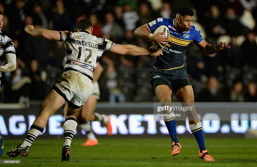 Kallum Watkins of Leeds Rhinos is tackled by Mark Minichiello of Hull FC during the First Utility Super League match between Hull FC and Leeds Rhinos...