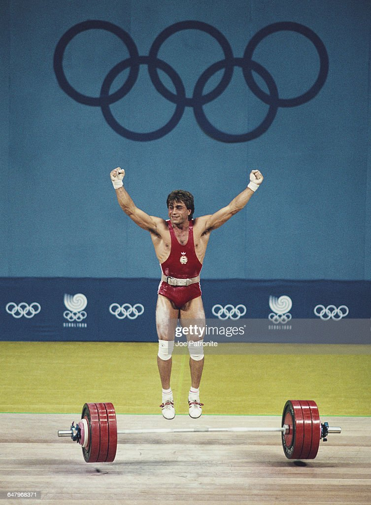 Kalman Csengeri of Hungary celebrates his winning lift before being disqualified for the illegal use of performance enhancing drugs during the Men's...